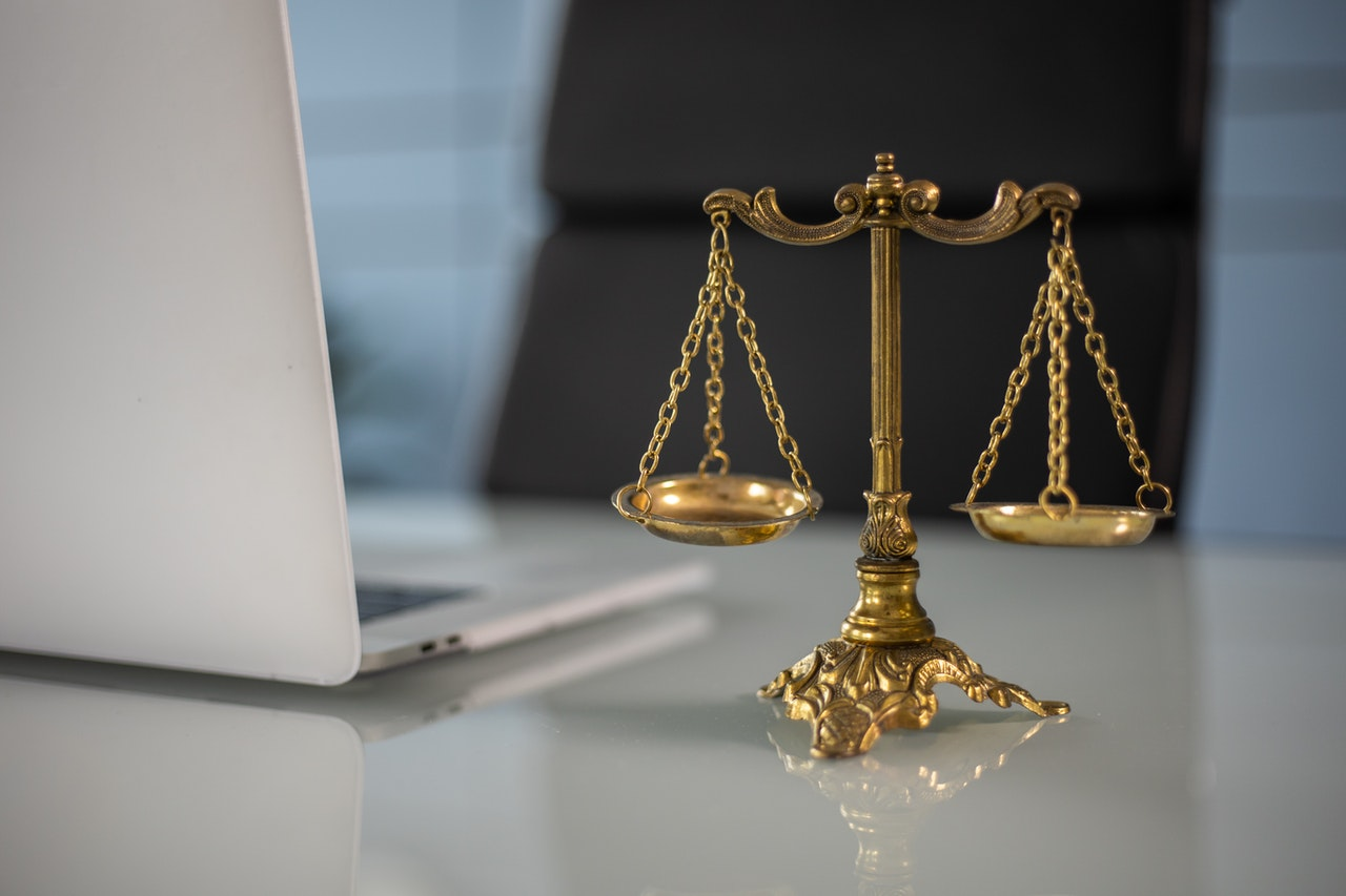 gold justice symbol on a table